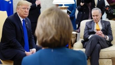 Donald Trump gives Nancy Pelosi a stern look.